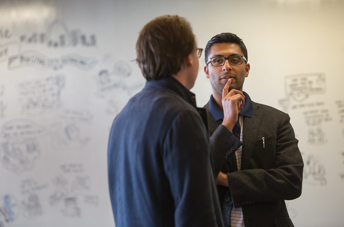 """Max Karacz (left), of Hamburg, Germany, and Faisal Delawalla, a Chicago associate, talk during Bryan Cave's two-day Business Academy for young associates. E-mail invitations sent to the associates read in part, """"Are our clients trying to automate us out of existence? How do we lead the law firm of your future in an age of innovation and automation?""""<em>Karen Elshout</em>"""