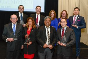 Some of the winners of Vanguard Awards on April 10 pose with their awards. Front, left to right: U.S. District Judge Marvin E. Aspen; Andrea L. Zopp, CEO of World Business Chicago; Rishi Agrawal, owner of The Agrawal Firm; and Andrew S. Kang, legal director of Asian Americans Advancing Justice Chicago. Rear, left to right: Mitchell B. Goldberg, partner at Lawrence Kamin; Rouhy J. Shalabi, partner at Shalabi and Associates; Karina Ayala-Bermejo, president and CEO of Instituto del Progreso Latino; Magdalena Dolas, executive director of the Polish American Association; and Rudy A. Figueroa Jr., vice president general counsel and secretary for Mitsui Rail Capital.