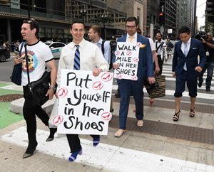 Members of The Chicago Bar Association's Young Lawyers Section cross Randolph Street in high heels June 14 as part of Walk a Mile in Her Shoes, an international fundraising march to stop rape, sexual assault and gender violence. Participants walked a literal mile in women's shoes, starting from Daley Plaza, to raise awareness about the serious causes and effects of sexualized violence against women. YLS co-sponsored the event with Between Friends, a nonprofit agency that serves domestic-violence victims.