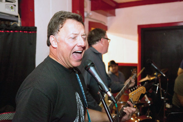 John G. Locallo sang his heart out as his band, 5-Thirty, played a show on Sept. 22 at Marie's Rip Tide Lounge in Chicago. Locallo, an attorney with  Amari & Locallo, said he enjoys playing music and practicing law. &nbsp;<em>Noah Gage</em>
