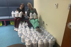 Edelson P.C. donated $15,000 to Chicago distillery Koval, which pivoted to producing hand sanitizer for hospitals and nursing homes during the novel coronavirus pandemic. Pictured is a some of the 175 gallons of hand sanitizer delivered to Advocate Christ Hospital in Oak Lawn.
