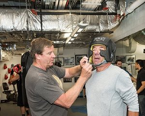 Glenn Leonard helps Peter Birnbaum, president and CEO of the Attorneys' Title Guaranty Fund, at Mercy Home's basement ring on Thursday, Sept. 14. Birnbaum  will face off against Paul Langer, Chicago office managing partner of Quarles & Brady, on Oct. 14 at the 26th annual Ringside for Mercy's Sake charity event to benefit Mercy Home.