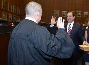 Judge Michael S. Kanne of the 7th U.S. Circuit Court of Appeals administered the oath of office to U.S. Attorney John R. Lausch Jr., his former law clerk, during his investiture at the Dirksen Federal Courthouse on Feb. 1.