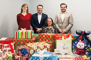 In December, Clark Hill participated in Dear Santa Letters, an initiative of The Chicago Bar Association's Young Lawyers Section in coordination with Direct Effect Charities. The program collects wish-list letters from disadvantaged Chicago students, then special gifts are bought, wrapped and delivered to those students' schools. Pictured with 100 donated presents are (left to right) Clark Hill receptionist Marykay Polito, member Ray J. Koenig III, legal assistant Tammy Braun and associate Chris Hopkins.