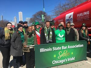 Illinois State Bar Association members marched in the St. Patrick's Day parade on March 17 in Grant Park alongside the bar group's Standing Committee on Marketing & Communications. Those pictured include Rooney Rippie & Ratnaswamy partner Emily Masalski, Momkus McCluskey member James F. McCluskey, Eric Hanis, Ava George Stewart, K & R Family Legal Services partner Anna P. Krolikowska, Amari Locallo partner John G. Locallo, ISBA president and former Cook County circuit judge Russell W. Hartigan, Illinois Secretary of State Jesse White, Bruce Farrel Dorn & Associates associate John R. Bailen, Boudreau & Nisivaco partner John L. Nisivaco and Azar Alexander, law clerk to Circuit Judge Diane J. Larsen.
