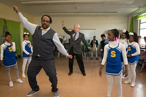 Union League Boys & Girls Clubs Trustee Stephen J. Schlegel dances with members of the ULBGC Stagg Club's dance team. Club youth participate in the afterschool program at Stagg Elementary in Englewood. Schlegel recently received the prestigious Boys & Girls Club of America's National Gold Medallion Award recognizing his 39 years volunteering with the organization.