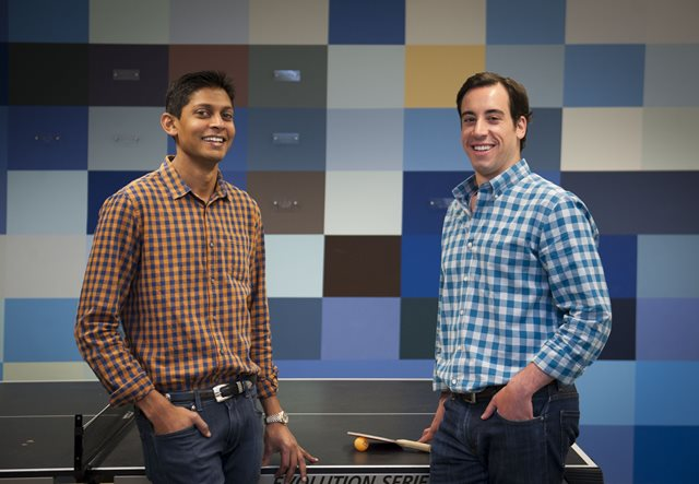 Entrepreneurs Vishal Shah (left) and Ryan Leavitt co-founded Catapult Chicago, a community and co-working space for digital startups, alongside Foley & Lardner partners Galen Mason and Chris Cain. They are pictured here at the Catapult offices, which are housed in the same building as Foley. - Rena Naltsas
