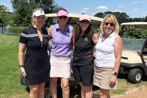 The Women's Bar Association of Illinois held its 24th Annual WBAI Golf Outing Aug. 9 at Glenview Park Golf Club. The event drew 120 golfers including, from left, Betsy Nelson, WBAI President Corinne C. Heggie, Deane Brown, and Annika Mitchell. The outing also featured a cocktail and dinner reception, as well as raffle prizes such as signed Chicago Bears jerseys, boat cruises and hotel getaways.