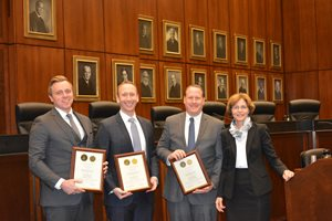 The U.S. District Court for the Northern District of Illinois honored Greenberg Traurig associates (from left) Kyle L. Flynn and Ian D. Burkow and shareholder Charles B. Leuin with its Excellence in Pro Bono Service Award on May 1 at the Dirksen Federal Courthouse for their work on behalf of a client who brought a racial discrimination suit against his employer and former supervisors. They're pictured with District Judge Rebecca R. Pallmeyer.