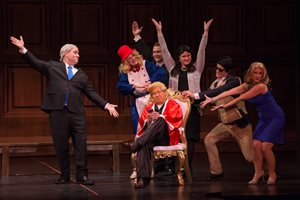 "Attorney Michael S. Weaver (seated) performs as a tweeting Donald Trump surrounded by well-known White House characters during ""Much to Sue About Nothing,"" The Chicago Bar Association's 94th annual bar show. It ran Nov. 30 through Dec. 3 at DePaul University's Merle Reskin Theater."