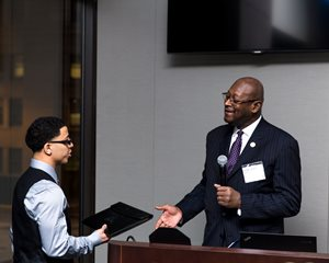 Nixon Peabody hosted the second annual Sandra Otaka Judicial Reception on March 28, spearheaded by the Asian American Bar Association. Supreme Court Justice P. Scott Neville Jr. is pictured here greeting Jeffrey Otaka, the son of the event's namesake, the late circuit judge Sandra Otaka, the first Asian-American judge appointed and elected in Cook County.
