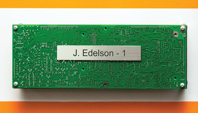 Circuit board name plates indicate the order employees came to the firm.  - Natalie Battaglia