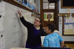 Julia A. Derish, associate at Skadden, Arps, Slate, Meagher & Flom, works with a student at O.A. Thorp Scholastic Academy on the city's Northwest Side through the Constitutional Rights Foundation Chicago's Lawyers in the Classroom program.