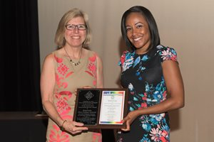Cook County Circuit Judge Mary Colleen Roberts (left) receives a plaque from Jennifer M. Ballard-Croft, chief of staff to Cook County State's Attorney Kimberly M. Foxx, at the state's attorney's office's 2018 Pride Recognition and Awards Ceremony at the Center on Halsted on June 26. Roberts, a judge since 2006, is assigned to the circuit court's Domestic Relations Division. She's a founding member of the Alliance of Illinois Judges, an organization founded in 2009 by openly gay and lesbian members of the judiciary.