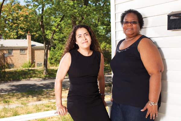 Kathleen Robson (left), a pro bono foreclosure defense lawyer, helped save Marjorie Pandy's home by striking a deal to reduce her monthly mortgage payment. Robson represents one of the about 400 attorneys trained by Chicago Volunteer Legal Services to handle the mediation process, which saw 4,072 cases since it began in 2010.&nbsp;<em>Lisa Predko</em>