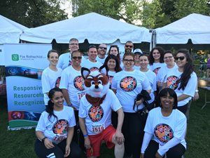 Three months after the merger of Shaw Fishman Glantz & Towbin and Fox Rothschild, the newly doubled Chicago office of Fox Rothschild posed for a pre-race photo with the firm's fox mascot.