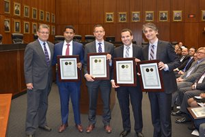 Chief Judge Rubén Castillo (left) presents awards for excellence in pro bono service to (left to right) Karim Basaria, Jeffrey R. Carroll, Benjamin R. Brunner and Daniel M. Greenfield, attorneys at Sidley Austin LLP, at the U.S. District Court for the Northern District of Illinois' 18th annual Awards for Excellence in Pro Bono and Public Interest Service Ceremony on May 24.